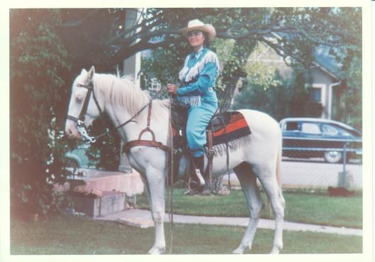Mom aboard sister's stallion 1960