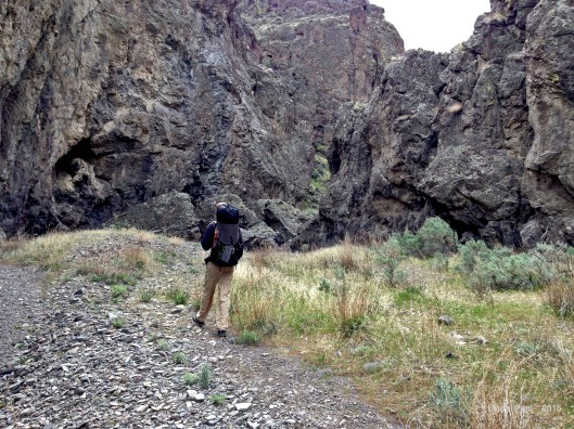 The size of the canyon walls makes this 6'4' hiker look like a midget.