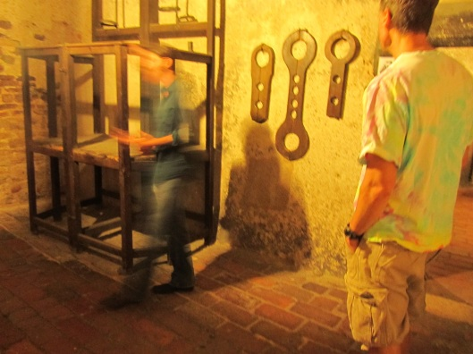 Those wrenches on the wall are for angry housewifes.  With hands bound 2 women are clamped in the device by the neck, facing each other. They remain in the town square in that awful posture until they've forgotten why they were mad at each other. Clever, no?