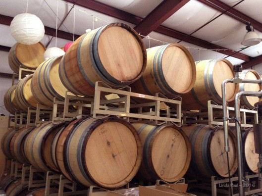 Appropriately enough wine barrels oversaw the eating frenzy.